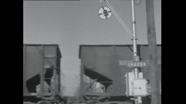 train passes level crossing - 1961 stock videos & royalty-free footage