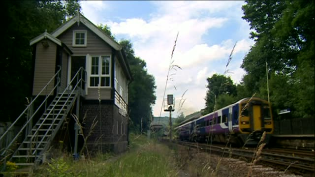 train passes listed signal box in hebden bridge - signal box stock videos & royalty-free footage