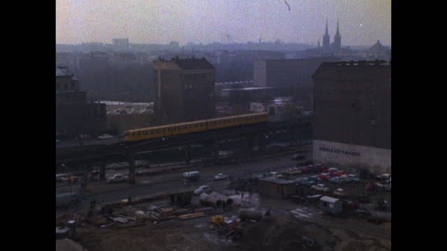 has train passes over bomb-damaged area in east berlin; 1969 - establishing shot stock videos & royalty-free footage