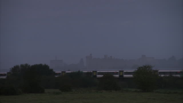 a train passes the arundel castle on a misty day. - arundel castle stock videos & royalty-free footage