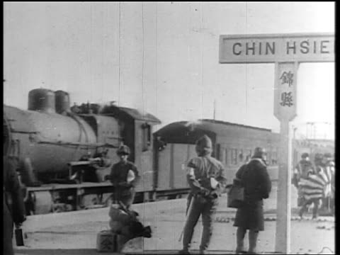 train passing behind soldiers on platform / japan invading manchuria - 1931 stock videos & royalty-free footage