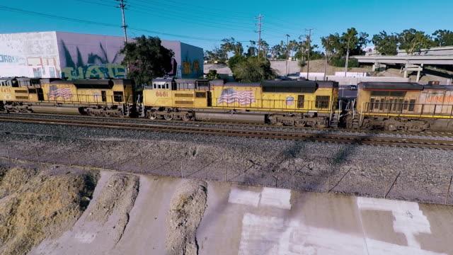 train passing bridge la river - cargo train stock videos & royalty-free footage