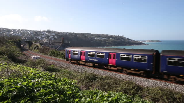 train passing by carbis bay beach as u.k. pickscornwallfor in person g7 summit in june, in carbis bay, cornwall, u.k., on friday and saturday,... - beauty in nature stock videos & royalty-free footage