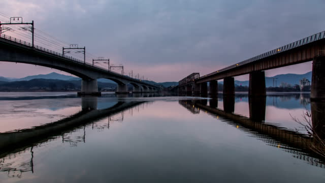 train passing by in the morning in yangsuri, kyonggi-do - railway bridge stock videos & royalty-free footage