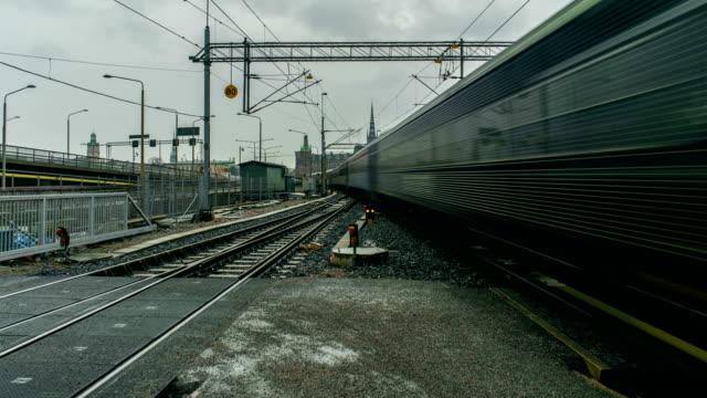 vidéos et rushes de train passing by stockholm sweden time lapse - suède