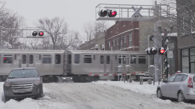 ws l train passing in winter weather - boom barrier stock videos & royalty-free footage