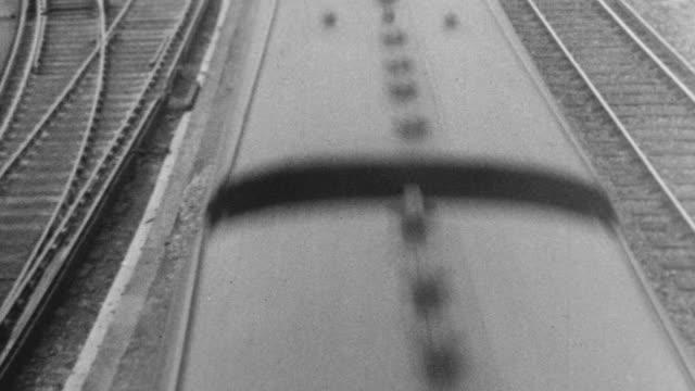 1939 HA Train passing over set of tracks / United Kingdom