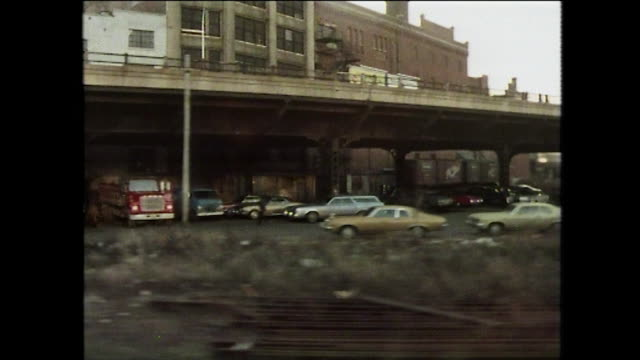 train pov passing run-down district of new york; 1975 - parking stock videos & royalty-free footage