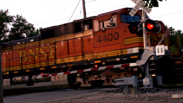 train passing the cross guard - rail freight stock videos and b-roll footage