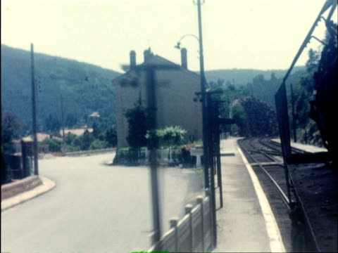 ms train passing through coastal tracks / united kingdom - bahnreisender stock-videos und b-roll-filmmaterial