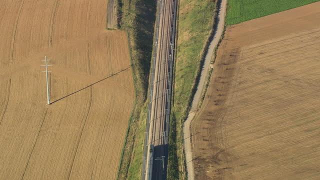 vidéos et rushes de ms aerial tgv train passing through farm field / picardy, france - voie ferrée