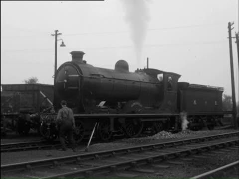 WS Train passing through industrial town / Scotland