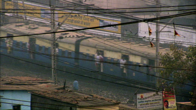 train passing through slum district. available in hd. - passenger stock videos & royalty-free footage