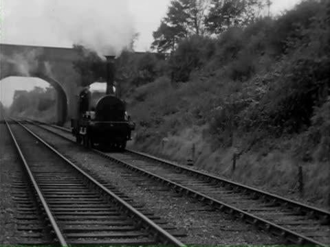 ms cu train passing under bridge and  driver oiling  wheels \ united kingdom - arch bridge stock videos and b-roll footage