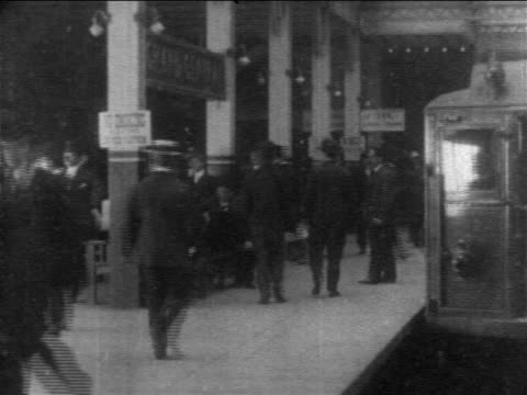 b/w 1905 train point of view behind subway at grand central station / nyc / documentary - new york city subway stock videos & royalty-free footage
