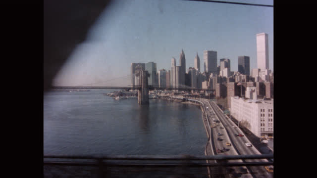 train point of view of cityscape and brooklyn bridge seen from manhattan bridge passing over east river, manhattan, new york city, new york state, usa - suspension bridge stock videos & royalty-free footage