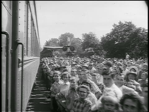 b/w 1952 train point of view past large crowd / some wave / eisenhower whistlestop campaign / newsreel - anno 1952 video stock e b–roll