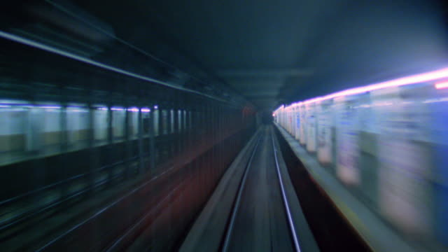 train point of view through tunnel and entering subway station / new york city - new york city subway stock videos & royalty-free footage