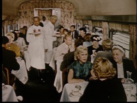 1955 ms train porters serving people in dining car of train - porter stock videos & royalty-free footage