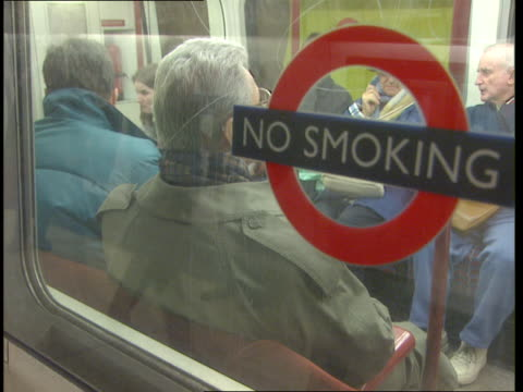train pulling away from platform at charing cross station london - 禁煙マーク点の映像素材/bロール