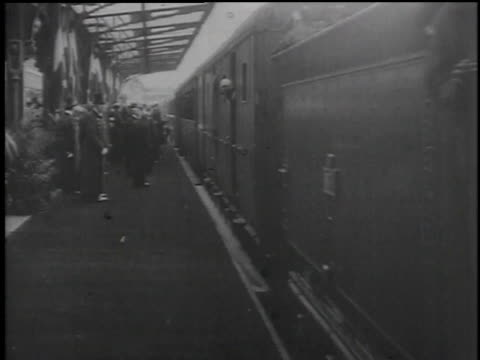 train pulling into station and leaders and dignitaries walking on platform / paris, france - 1918 stock videos & royalty-free footage