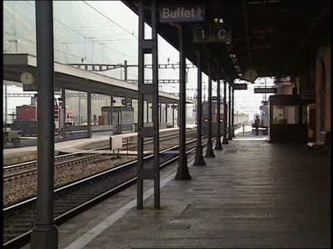 train pulling into station  biasca train station  switzerland - bahnreisender stock-videos und b-roll-filmmaterial