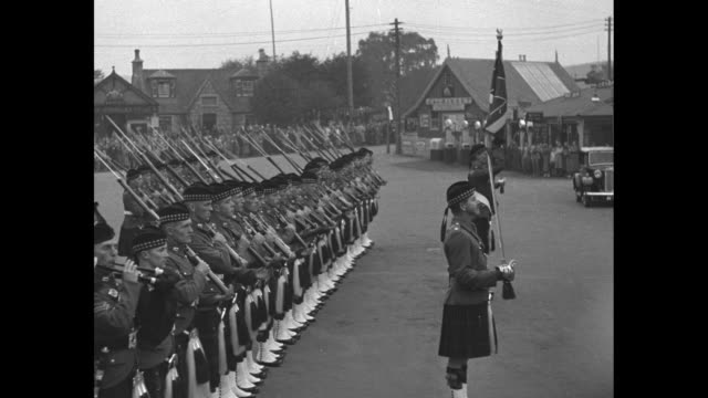 train pulling into station / sign for ballater scotland / guard of honour of gordon highlanders present arms / edward viii greets members of guard of... - tartan stock videos & royalty-free footage