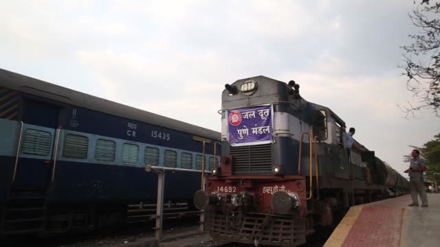 a train pulling water tankers stands at latur railway station in latur maharashtra india on saturday april 16 a banner is tied at the front of a... - maharashtra stock-videos und b-roll-filmmaterial