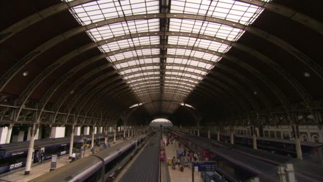 a train pulls into paddington railway station in london. available in hd. - paddington railway station stock videos & royalty-free footage