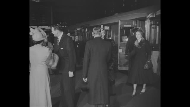 Train pulls into station as Danish royal family members arrive in London for exhibition of Danish art / Denmark's King Frederick IX approaches King...