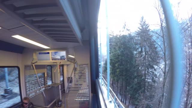 train ride from wengen to lauterbrunnen, jungfrau region, bernese oberland, swiss alps, switzerland, europe - bahnreisender stock-videos und b-roll-filmmaterial