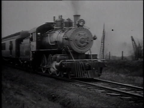 stockvideo's en b-roll-footage met 1925 ws train rides the tracks / united states - locomotief