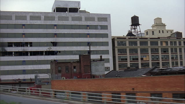 side pov train riding through industrial area, new york - 2001 stock videos & royalty-free footage