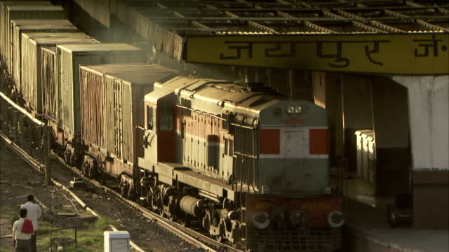 a train rolls away from the platform at the train station in jaipur, india. available in hd - c119gs stock videos & royalty-free footage