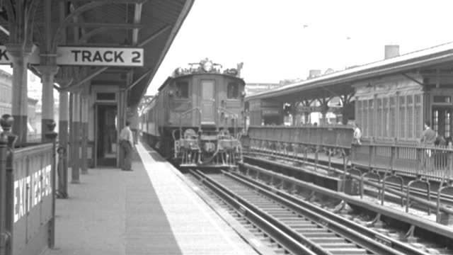 a train rolls into new york city's 125th street station in a 1937 vintage film. - 1937 stock videos & royalty-free footage