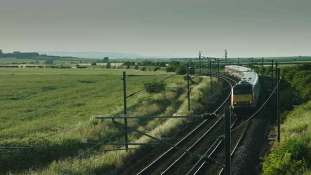 Train Rounding Bend in Rural Landscape