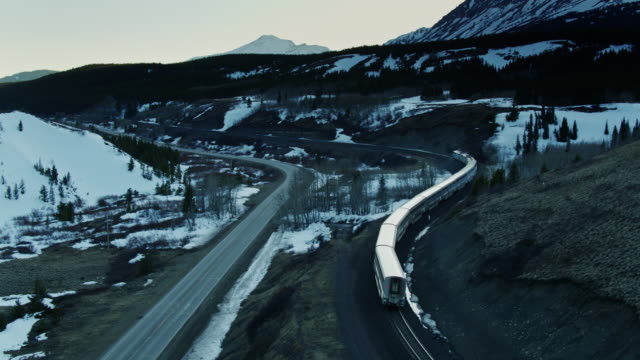 train rounding curves in montana - aerial - glacier national park us stock videos and b-roll footage