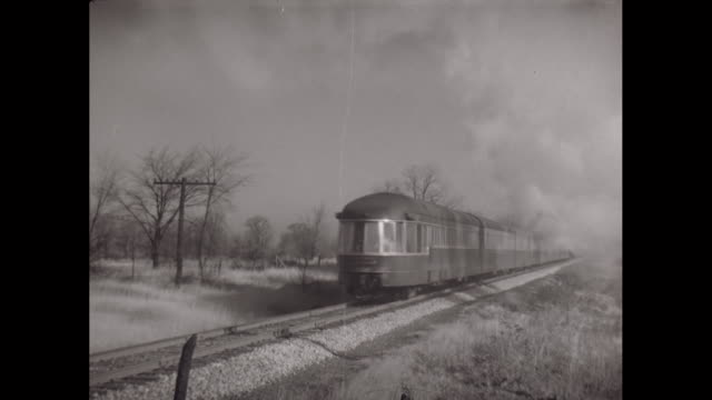 ws pan train running on railway track / united states - モノクロ点の映像素材/bロール