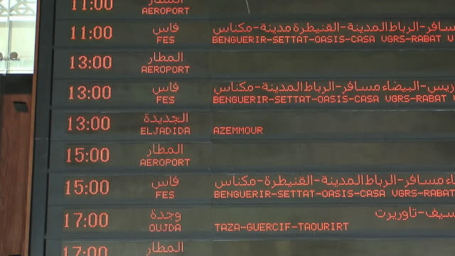 MS TD Train schedule board in French and Arabic, Marrakech, Morocco