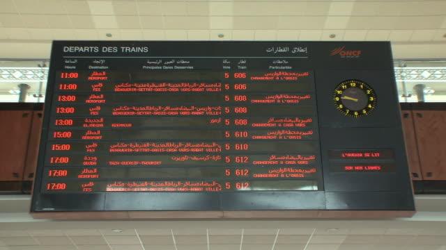 MS LA ZO Train schedule board in French and Arabic, Marrakech, Morocco