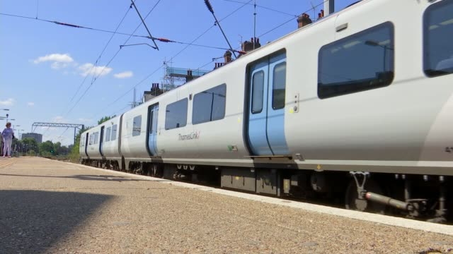 train service cancellations continue at west hampstead following heatwave england london ext commuter on phone waiting for train general views of... - heat stock videos & royalty-free footage