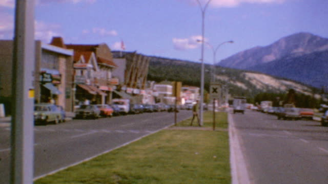 train station and totem pole / main street and cars / bank of commerce / parked rv / downtown jasper on august 20, 1971 in jasper, alberta - alberta stock videos & royalty-free footage