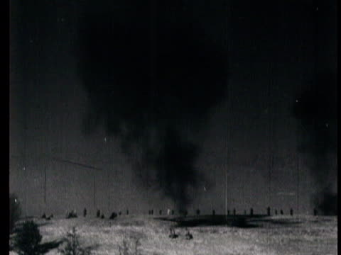 Train station cannons firing bombs blast Red Army enter garrison town abandoned German equipment dead Nazi soldiers frozen bodies dead bodies hanged...