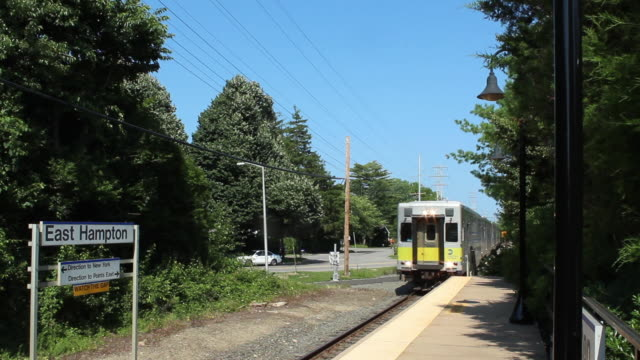 train stops at the east hampton station stop - long island railroad stock videos & royalty-free footage