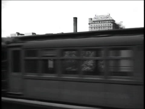 train through town and industrial area on january 01, 1945 - zugperspektive stock-videos und b-roll-filmmaterial