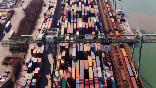 train tracks and container yard in the port of dortmund - aerial shot - attrezzatura industriale video stock e b–roll