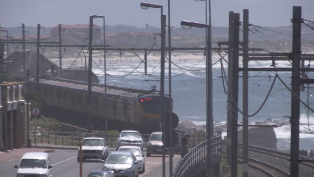 train tracks and road next to coastline, south africa - next to stock videos and b-roll footage