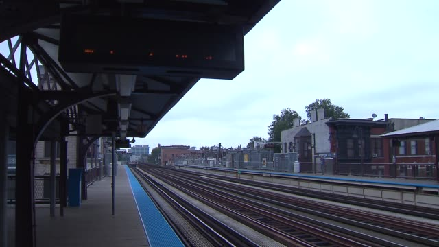 train tracks at station - chicago 'l' stock videos and b-roll footage