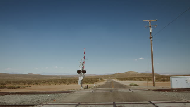 train tracks in the mojave desert. - level crossing stock videos & royalty-free footage
