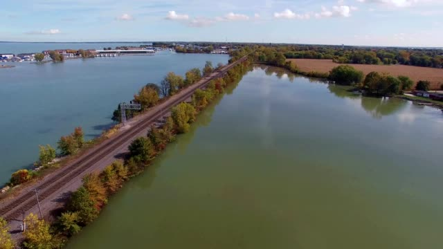 train tracks over water in port clinton ohio - ohio stock videos & royalty-free footage